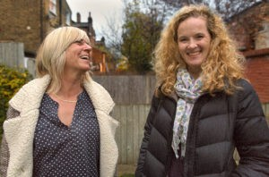 An image of good quality of life: a transgender woman and her daughter laughing together