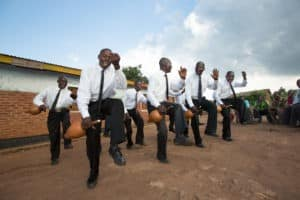 An image of good quality of life: a community in Malawi coming together through music, dance, and song.